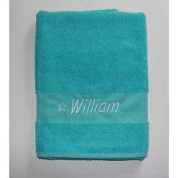 Stort tyrkisblåt håndklæde med navn på
